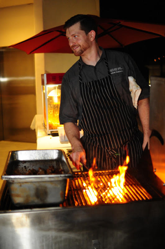 Stake's chef cooks up more skewers for his customers.