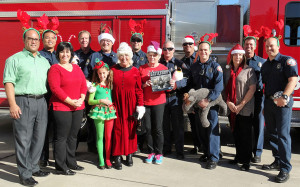 From left: Fr. Joe's Dir. of Bus. Operations Oscar Labiano, FF/Paramedic Jon Feliciano, Fr. Joe's Exec. Asst. Gena Mayor, Engr. Brian Clark, Fire Chief Mike Blood, Elf (Mia Carpenter), Mrs. Clause (Bonnie Carpenter), Capt. Jason Clements, Kathie Parish (CFC), Bt. Chief Bill Toon, Capt. Darren Hall, FF/Paramedic Nate Ramos, CFC Co-President Molly Korson, Engr. Eric Hingeley, FF/Paramedic Brian Standing. Photo: Lamarshell Karnas
