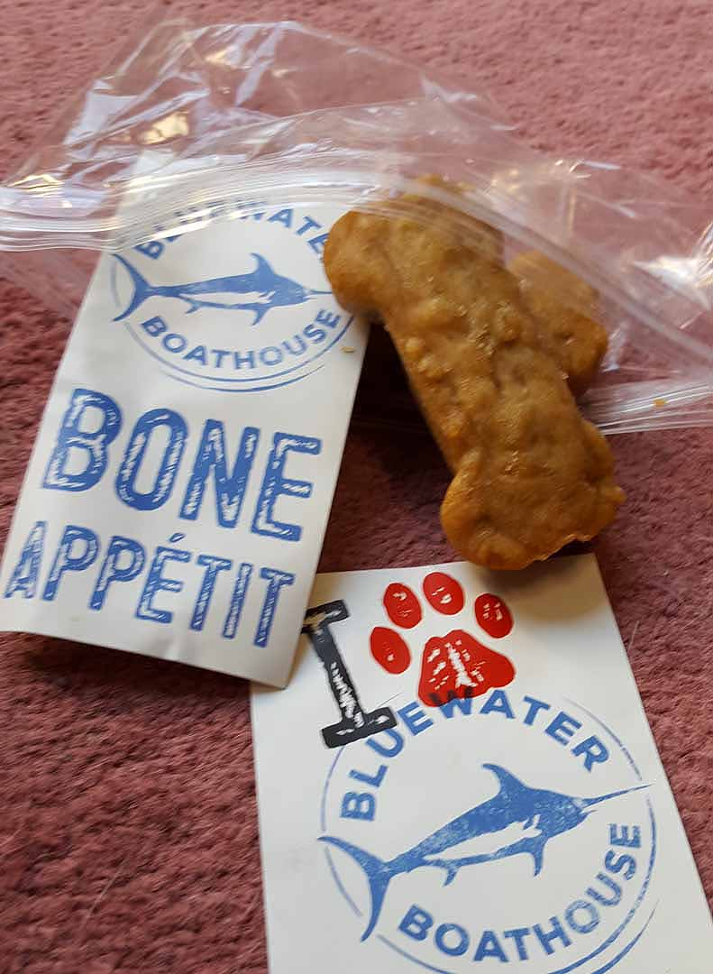 These tiny doggie bags were left over from a recent promotion. Bluewater Boathouse staff are handing them out along Shipwreck and Center Beach while the supply lasts.