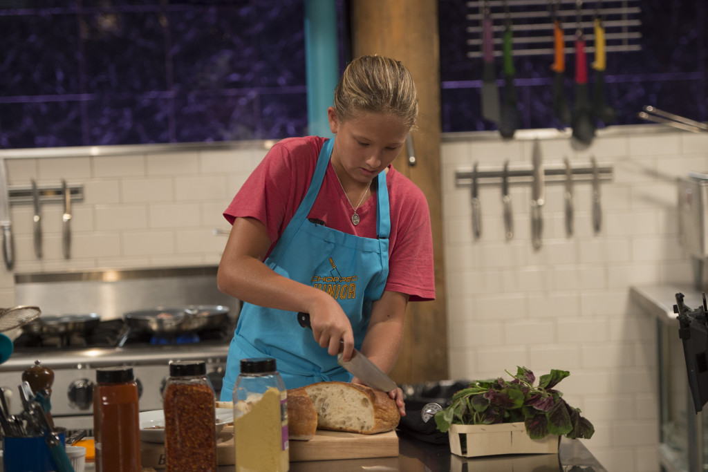 Junior competitor Cookie Dutch races to finish her round 1 dish which must include steak tartare, malabar spinach, blooming onion, and barbecue-flavored larvae, as seen on Food Network's Chopped Junior, Season 1.