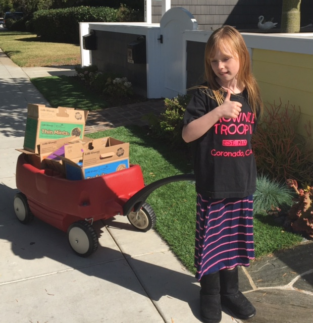 Grace selling Girl Scout cookies for Brownie Troop 1. (Photo courtesy of Julie Dabbieri)