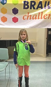 Grace showing the award she won at the Southern California Braille Challenge on January 30, 2016. (Photo courtesy of Julie Dabbieri)