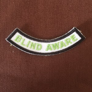 The patch earned by Brownie Troop 1 after Grace led a meeting where she taught the girls about her blindness and showed them Braille.
