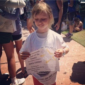 Grace showing the award she won at summer camp. (Photo courtesy of Julie Dabbieri)
