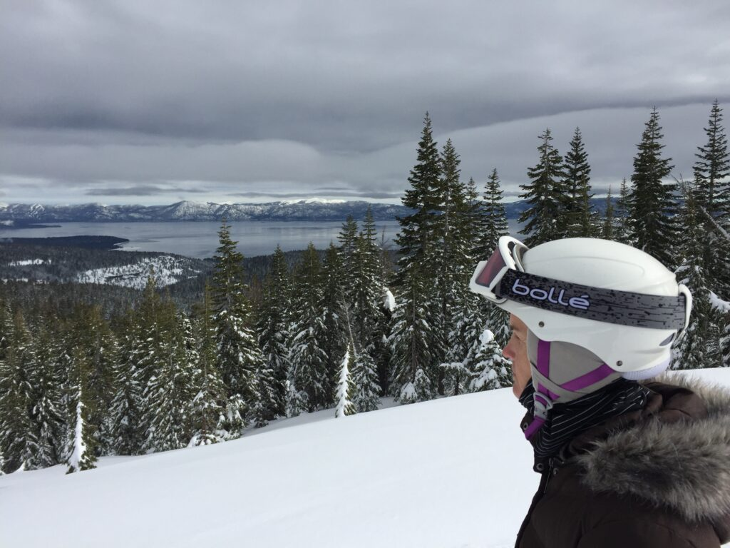 Taking a break from a ski run at Squaw Valley / Alpine Meadows. Lake Tahoe is visible in the background.