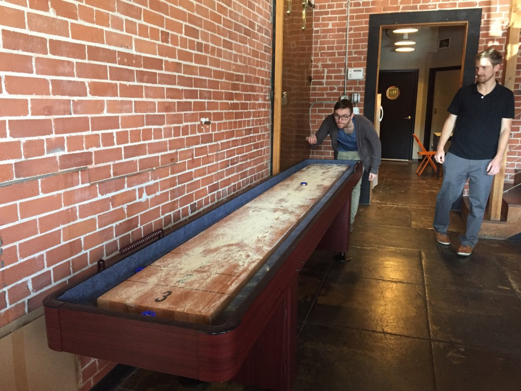 No wonder Jacques Spitzer is able to maintain such a strong team at Raindrop Marketing! Work is fun! There's even a shuffleboard table at the office!
