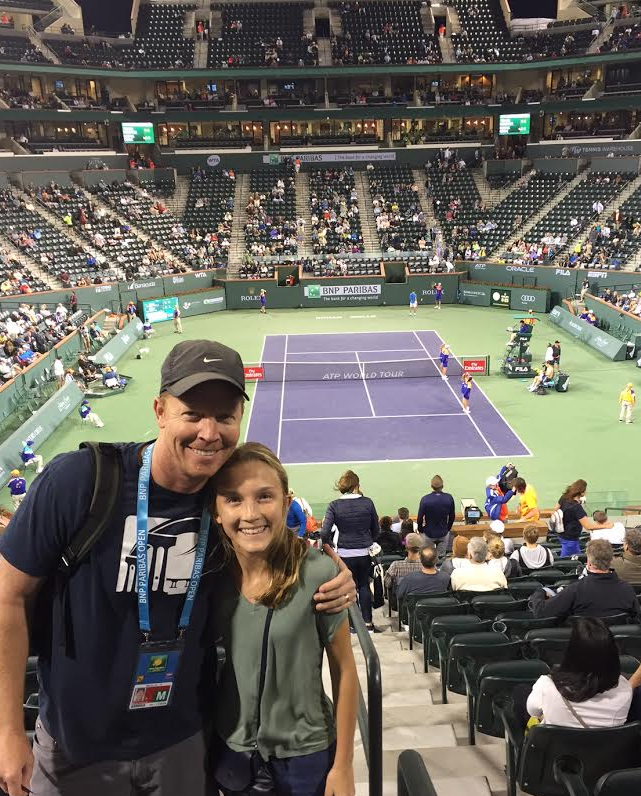 Watching tennis together at this event was a bonding experience for this father-daughter.