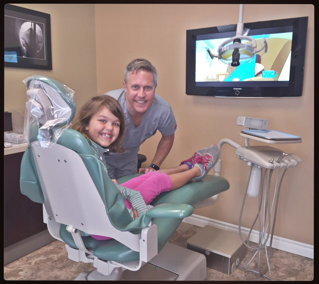 Dr. Mullins, seen here with his patient Islay Andersen, makes going to the orthodontist a fun experience for kids.