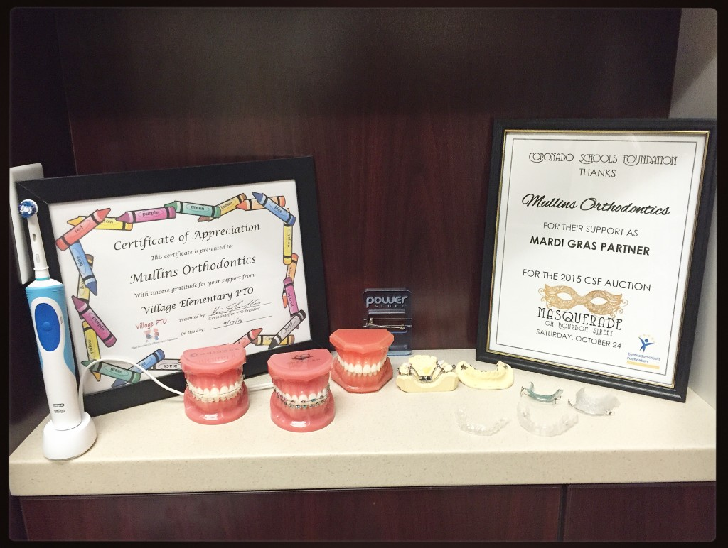 Some of the various tokens of appreciation from organizations in the community thanking Mullins Orthodontics for its help with fundraising.