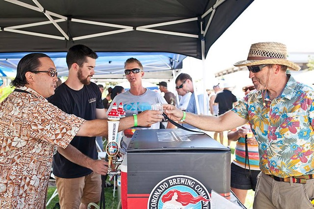 Mayor Tanaka proudly pouring tastes of Coronado Brewing Company's best brews at Beer by the Bay 2015. Image courtesy of Islander Ladies Club.