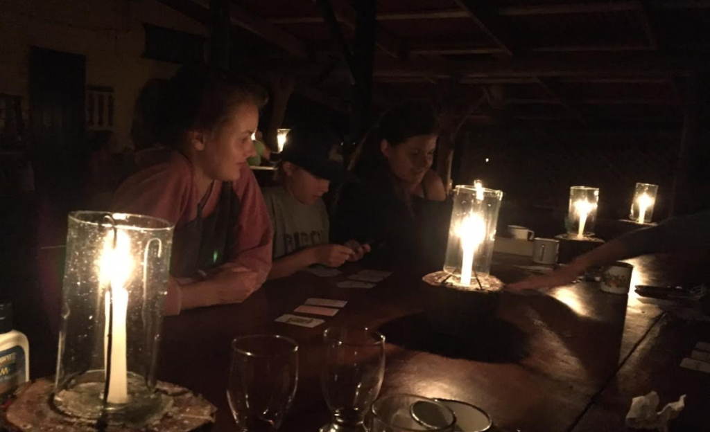 Meeting new friends and playing cards during dinner.