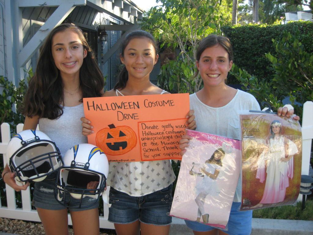 Paloma Ronis, Samantha Lorr, Amelia Hawley are collecting gently used Halloween costumes for the Monarch School. Submitted photo.