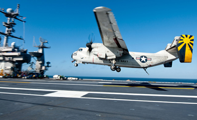 PACIFIC OCEAN (June 27, 2012) A C-2A Greyhound assigned to the Providers of Fleet Logistics Combat Squadron (VRC) 30 lands on the flight deck of the Nimitz-class aircraft carrier USS John C. Stennis (CVN 74). Stennis is in transit to San Diego for fleet replenishment carrier qualifications. (U.S. Navy photo by Mass Communication Specialist Seaman Nolan Kahn/Released)