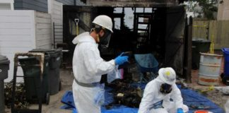 hazardous materials cleanup involving local and federal health officials