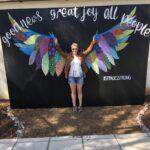 Dani in front of mural